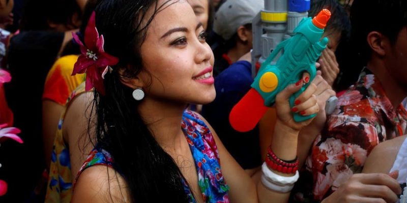 A reveller reacts during a water fight at Songkran Festival celebrations in Bangkok
